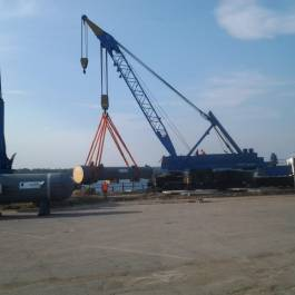 Loading-out oil and gas equipment at Samara river port, pieces of freight from 27 tons to 135 tons and transportation by road to the refinery