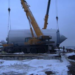 Transshipment of 12 CCT, dimensions of 20.0 x 6.0 x 6.1 m weight 26 tons in Ulyanovsk and further road transportation to the brewery
